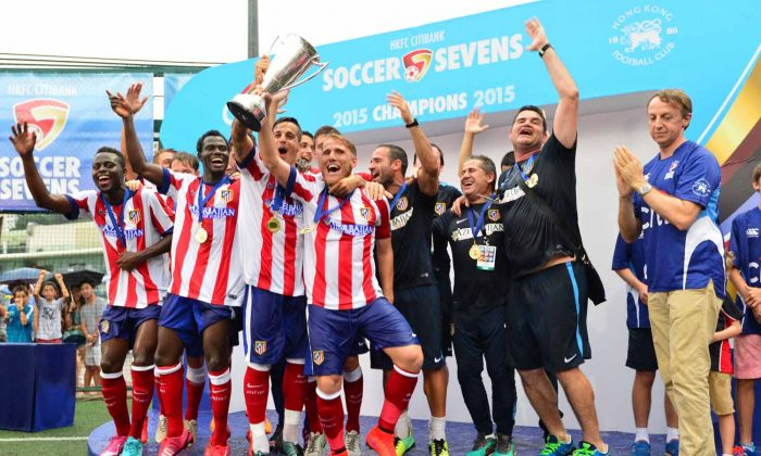 Atletico Madrid winners of the HKFC Citibank Soccer Sevens Cup at the Hong Kong Football Club on Sunday May 31, 2015. (Bill Cox/Epoch Times)