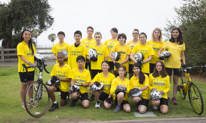 """Youth Ambassadors"" from more than 10 countries pose for a photo before a rally Sunday, May 31. They are cyclists for Ride to Freedom, a group of 30 young people who will bike from Los Angeles to Washington, D.C., and finally New York on a 3,000 mile trip to ultimately rescue five orphans in China whose parents were killed because of their beliefs."