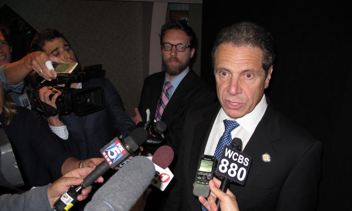 New York Gov. Andrew Cuomo speaks with reporters on Wednesday, June 3, 2015, in Seaford, N.Y. (AP Photo/Frank Eltman)