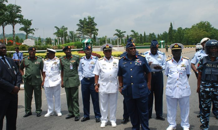 Nigeria's chief of defense staff Air Marshal Alex S. Badeh, (foreground third from R), and other military chiefs wait to address the Nigerians Against Terrorism group in Abuja, Nigeria, on May 26, 2014. Nigerian military abuses caused the deaths of some 8,000 people in the fight against Boko Haram extremists, Amnesty International said Wednesday, June. 3, 2015  in a report naming senior officers it wants investigated for alleged war crimes.  (AP Photo/Olamikan Gbemiga File)