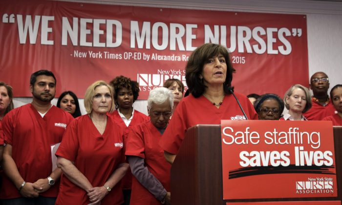 President Judy Sheridan-Gonzalez, at podium, of the New York State Nurses Association, addresses a news conference, in New York, Wednesday, June 3, 2015. (AP Photo/Richard Drew)