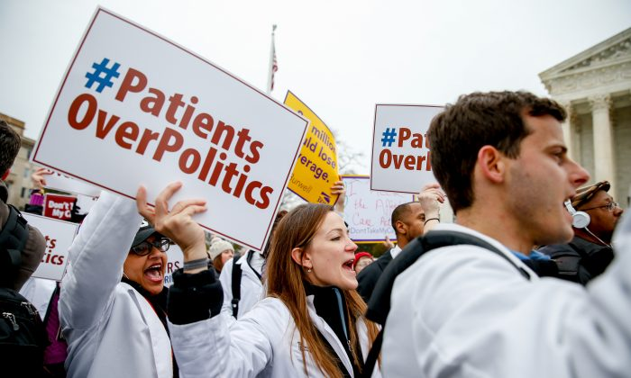 FILE - In this March 4, 2015 file photo, demonstrators chant during health care rally outside the Supreme Court in Washington.  (AP Photo/Andrew Harnik, File)