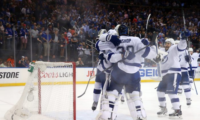 Ben Bishop of the Tampa Bay Lightning celebrates with his teammates after blanking the New York Rangers in Game 7 at Madison Square Garden on May 29, 2015 in New York City. The Lightning take on the Chicago Blackhawks in the Stanley Cup final. (Elsa/Getty Images)