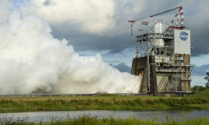 A billowing plume of steam signals a successful 450-second test of the RS-25 rocket engine May 28 at NASA's Stennis Space Center near Bay St. Louis, Mississippi. (NASA)
