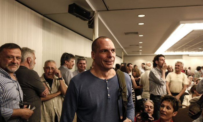 """Greece's Finance Minister Yanis Varoufakis arrives for a Syriza party central committee meeting in Athens, Greece, on Saturday, May 23, 2015. Tsipras has told leaders of the governing Radical Left Coalition that Greece is ready to accept a """"viable and long lasting"""" deal with its lenders, but not on """"humiliating terms."""" (AP Photo/Yorgos Karahalis)"""