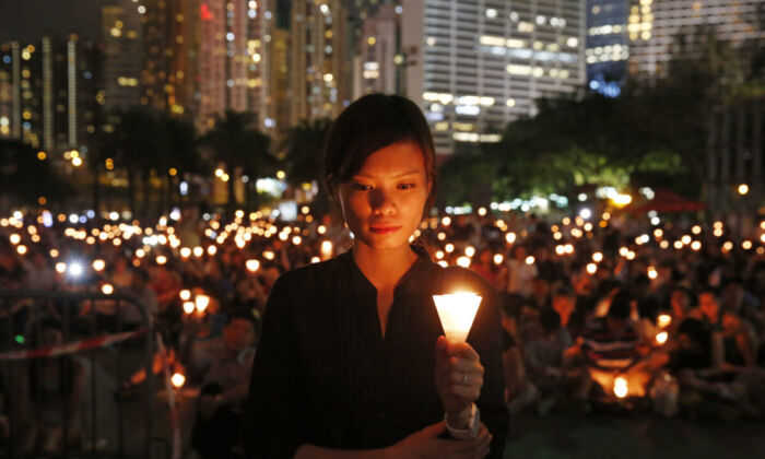 Tens of thousands of people attend a candlelight vigil at Victoria Park in Hong Kong on June 4, 2015. (Kin Cheung/AP Photo)
