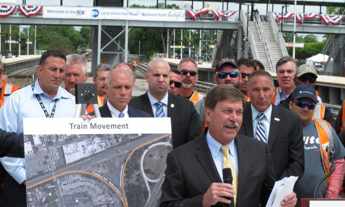 In this photo taken Thursday, June 4, 2015, Long Island Rail Road President Patrick Nowakowski speaks at a news conference at the opening of a renovated Belmont Park train station. (AP Photo/Frank Eltman)
