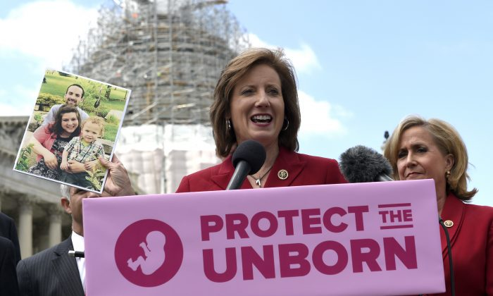 Rep. Vicky Hartzler, R-Mo., center, speaks during a news conference on the Pain-Capable Unborn Child Protection Act  on Capitol Hill in Washington, Wednesday, May 13, 2015.  (AP Photo/Susan Walsh)