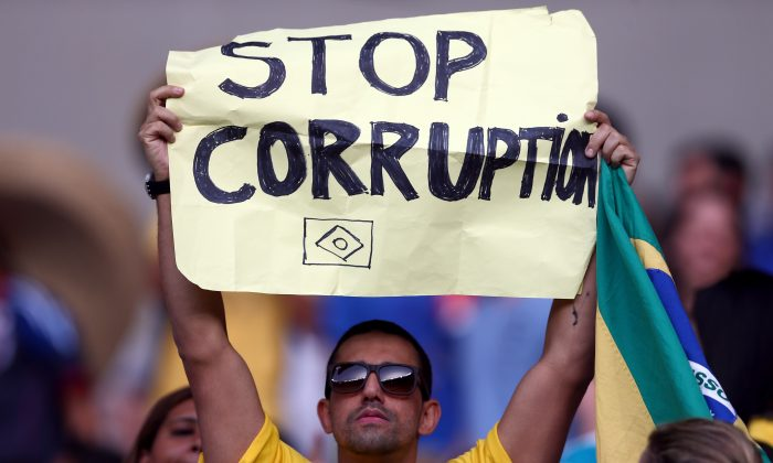 A fan holds up a sign about FIFA during the FIFA Confederations Cup Brazil 2013 n Belo Horizonte, Brazil, on June 22, 2013. (Ronald Martinez/Getty Images)