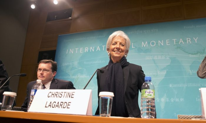 International Monetary Fund (IMF) Managing Director Christine Lagarde, right, arrives for a news conference in Washington, June 4, 2015. (AP Photo/Jacquelyn Martin)