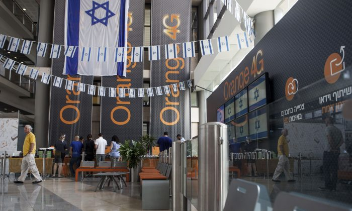 "Israeli flags are seen inside the ""Partner Orange"" Communications Company offices in the city of Rosh Haain, Israel, Thursday, June 4, 2015. (AP Photo/Dan Balilty)"