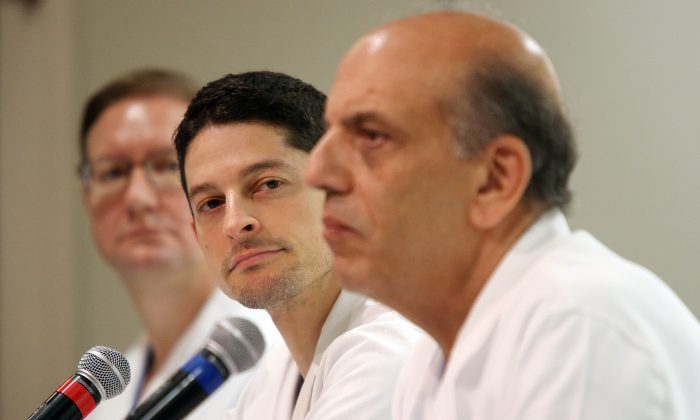 From left, Michael Kiebuc, MD, of Houston Methodist Hospital, Jesse C. Selber, MD, MPH, of MD Anderson Cancer Center, and A. Osama Gaber, MD, of Houston Methodist Hospital, describe the transplant surgery for Jim Boysen during a news conference at Houston Methodist Hospital on Thursday, June 4, 2015, in Houston. (Mayra Beltran/Houston Chronicle via AP)