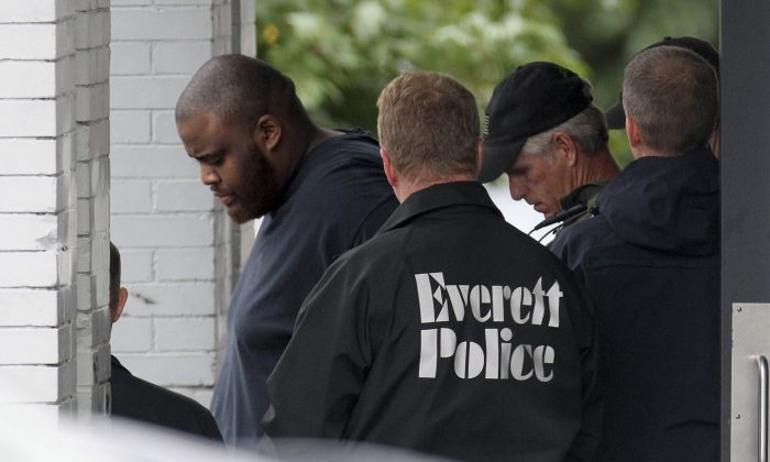 In this Tuesday, June 2, 2015 photo, authorities remove David Wright from a house in Everett, Mass., after a day-long police investigation at the property. (Boston Herald/John Wilcox via AP)