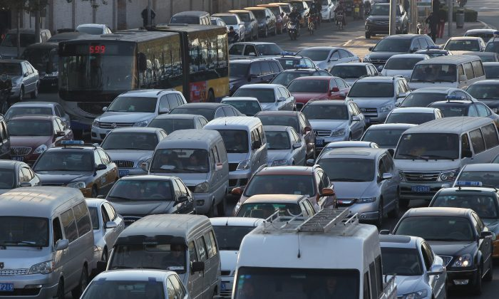 Road congestion appears after termination of odd-even traffic ban on November 13, 2014 in Beijing, China. (ChinaFotoPress/ChinaFotoPress via Getty Images)