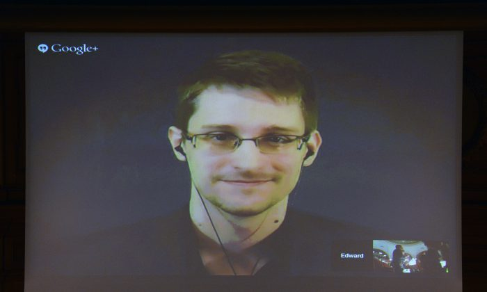 US National Security Agency (NSA) whistleblower Edward Snowden speaks via live video call during the Right Livelihood prize ceremony at the parliament in Stockholm, on December 1, 2014. (Jonathan Nackstrand/AFP/Getty Images)