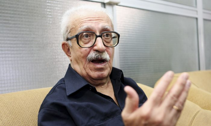 In this Sept. 5, 2010 file photo, Tariq Aziz, Saddam Hussein's long time foreign minister, speaks to the Associated Press in Baghdad, Iraq. Officials say Aziz has died in a hospital in southern Iraq on Friday, June 5, 2015. (AP Photo/Hadi Mizban, File)