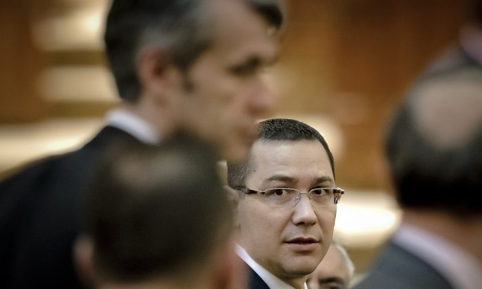 Romanian Premier designate Victor Ponta, right, is seen before a parliament session in Bucharest, Romania. (AP Photo/Vadim Ghirda)