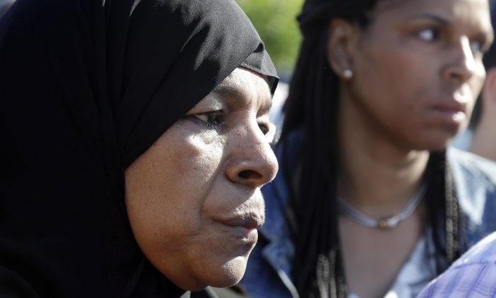 Rahimah Rahim, left, mother of shooting victim Usaama Rahim, listens during a news conference Thursday, June 4, 2015, in Boston's Roslindale neighborhood in the area where Rahim was shot to death. (AP Photo/Elise Amendola)