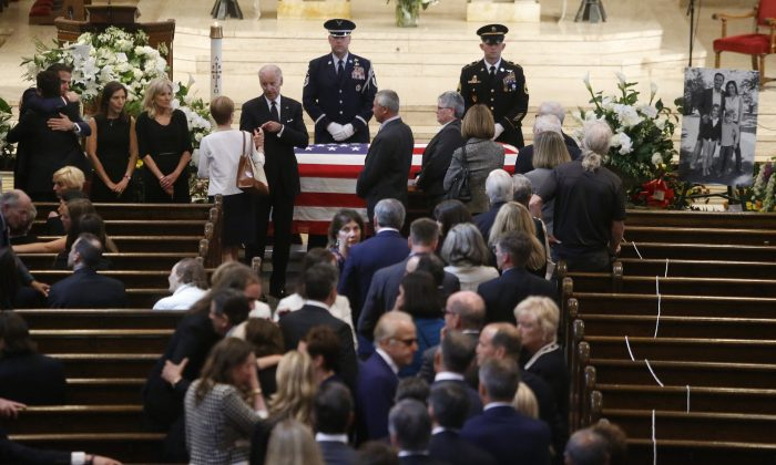 Family members of Beau Biden, including, facing camera, from top left, his brother Hunter Biden, widow Hallie Biden and parents Jill and Vice President Joe Biden, greet mourners at the viewing for the former Delaware Attorney General at St. Anthony of Padua in Wilmington, Del., Friday, June 5, 2015.  Biden, the eldest son of Vice President Joe Biden, died of brain cancer Saturday at age 46. (William Bretzger/The Wilmington News-Journal via AP, Pool)
