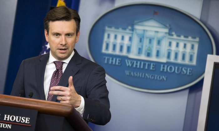 White House press secretary Josh Earnest speaks about the Chinese hack of the computer system of the Office of Personnel Management, Friday, June 5, 2015, during the daily press briefing at the White House in Washington. (AP Photo/Evan Vucci)