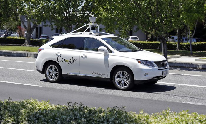 FILE - This May 13, 2014, file photo shows a Google self-driving Lexus at a Google event outside the Computer History Museum in Mountain View, Calif. (AP Photo/Eric Risberg, File)