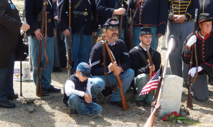 Civil War re-enactors gather Sunday, June 7, 2015, around the grave of Pvt. Scott Carnal of the 1st Kansas Colored Infantry during a ceremony Sunday in Dayton, Nev., 30 miles south of Reno. (Lynne Ballatore/Historical Society of Dayton Valley, via AP)