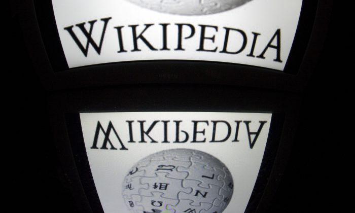 """In this file photo, yhe """"Wikipedia"""" logo is seen on a tablet screen on December 4, 2012 in Paris. (Lionel Bonaventure/AFP/Getty Images)"""