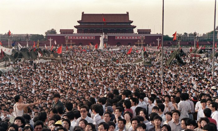 This file photo taken on June 2, 1989 shows hundreds of thousands of Chinese gathering around a 10-metre replica of the Statue of Liberty (C), called the Goddess of Democracy, in Tiananmen Square. (Catherine Henriette/AFP/Getty Images)