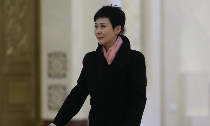 Li Xiaolin, former CEO of China Power International Development Ltd. and daughter of former Chinese Premier Li Peng, arrives at the Great Hall of the People on March 7, 2014 in Beijing, China. (Feng Li/Getty Images)