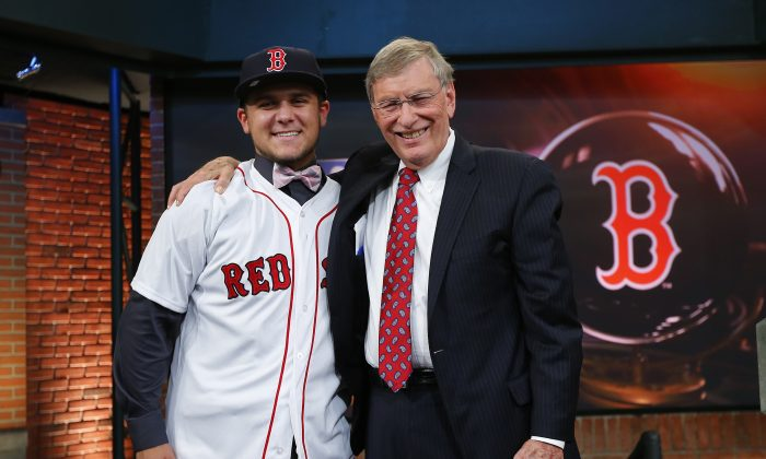 Michael Chavis (L) poses with former MLB Commissioner Allan H. Bud Selig after being chosen 26th overall by the Boston Red Sox during the 2014 MLB First-Year Player Draft. Chavis, an infielder is currently hitting .204 for Greenville—Boston's single-A team. (Rich Schultz/Getty Images)