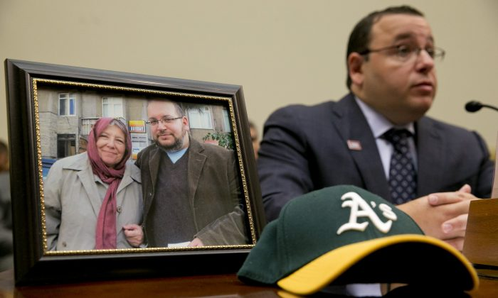 """TEHRAN, Iran (AP) — The mother of detained Washington Post correspondent Jason Rezaian said Monday that Iran has charged her son for simply """"reporting on a country that he loves,"""" as he addressed the judge overseeing his closed-door espionage trial.  Details of Rezaian's second court hearing remained vague in Iranian media accounts, although the semi-official Tasnim news agency said the 39-year-old bureau chief defended himself in English. The agency said a translator later handed Judge Abolghassem Salavati a transcript of Rezaian's remarks in Persian.  Rezaian faces charges including espionage and propaganda against the Islamic Republic, which the Post has said carry 10 to 20 years in prison if he is convicted. U.S. officials, the Post and rights groups have strongly criticized Rezaian's trial, demanding he be freed.  Rezaian's detention of over 300 days and his trial come as Iran negotiates with world powers over its contested nuclear program, leading many, including his mother, Mary, to suggest current events may play a role in his case.  """"Someone believes that there is an advantage to holding him,"""" Mary Rezaian told The Associated Press outside her son's hearing at Tehran's Revolutionary Court. """"Personally, I do not think so.""""  Standing next to his wife, Yeganeh Salehi, Mary Rezaian said her son is """"very tired, very distressed."""" She also said she didn't know how many more court hearings will be held or how the trial is going. Both she and Rezaian's wife have not been allowed to attend the hearings, although Mary Rezaian has seen him twice briefly since she arrived in Iran a month ago.  """"He is being accused of being a master spy when all he was doing was reporting on a country that he loves. So it is very hard for him. Very, very hard for him. And of course he misses his wife,"""" Mary Rezaian said. """"So two years they have been married, one year he has been in prison. It is a very, very difficult thing.""""  Salehi declined to discuss her husband's trial, only saying: """
