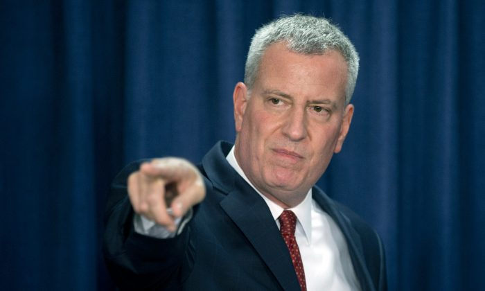 New York City Mayor Bill de Blasio takes a question during a news conference on Wednesday, May 27, 2015, in Albany, N.Y. De Blasio is in Albany to make his case for renewing mayoral control of city schools, strengthening the city's rent regulations and changing a tax break for real estate developers to require more affordable housing. (AP Photo/Mike Groll)