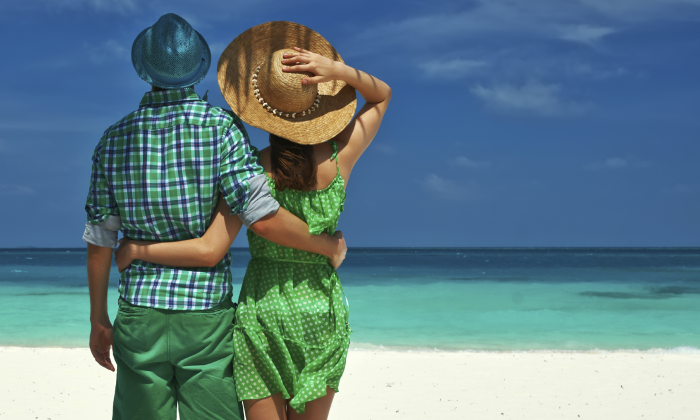 Sunscreen is an important tool for sun protection, but experts also advise wearing a hat and staying in the shade. (haveseen/iStock)