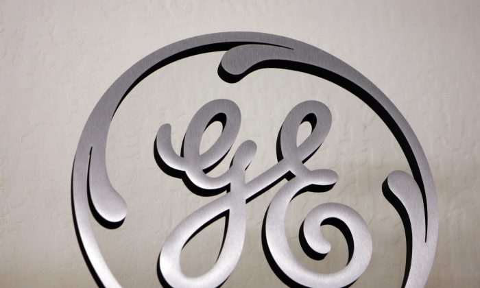 In this Dec. 2, 2008 file photo, a General Electric (GE) sign is seen on display at an appliance store in Mountain View, Calif. (AP Photo/Paul Sakuma)