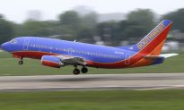 Southwest Flight Attendant Holds Crying Baby in Viral Video
