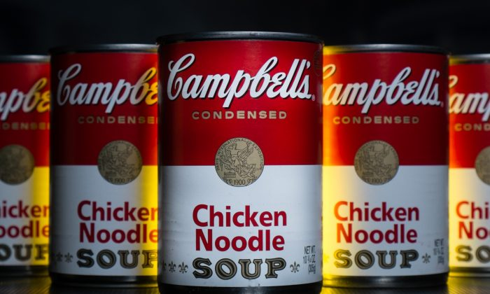 In this Wednesday, Jan. 8, 2014, photo, cans of Campbell's soup are photographed in Washington.  Campbell Soup reported a higher quarterly profit on Friday, Feb. 14, 2014, as U.S. soup sales rose 5 percent. (AP Photo/J. David Ake)