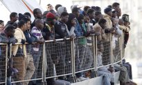 Dramatic Saves After Packed Migrant Boat Overturns in Med