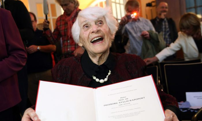 Ingeborg Syllm-Rapoport holds up her doctoral certificate during a ceremony at the University Clinic Hamburg-Eppendorf in Hamburg, Germany, Tuesday, June 9, 2015. (Bodo Marks/dpa via AP)