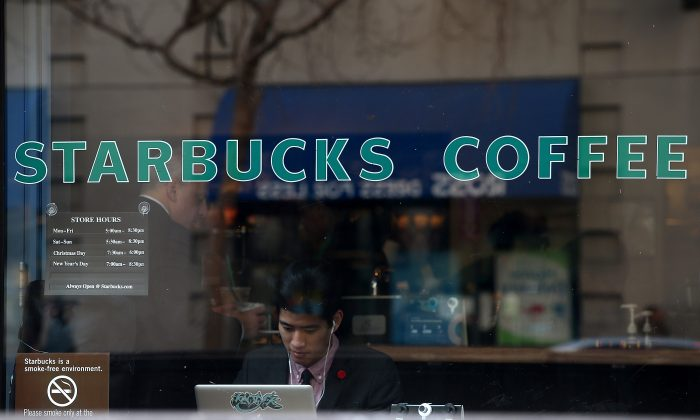 A Starbucks customer works on his laptop inside a Starbucks Coffee shop on January 22, 2015 in San Francisco, California.(Justin Sullivan/Getty Images)