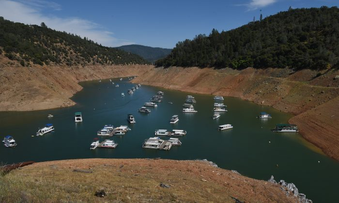 Houseboats are moored on a shrinking arm of the Oroville Lake reservoir which is now at less than 25 percent capacity as a severe drought continues to affect California on May 24, 2015. (Mark Ralston/AFP/Getty Images)
