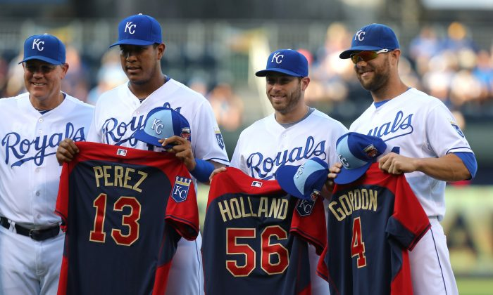 Royals manager Ned Yost (from L-R), catcher Salvador Perez, closer Greg Holland, and outfielder Alex Gordon all made the the All-Star team and are on pace to do the same this year—with plenty of company as the team is on pace to put start seven players. (Ed Zurga/Getty Images)