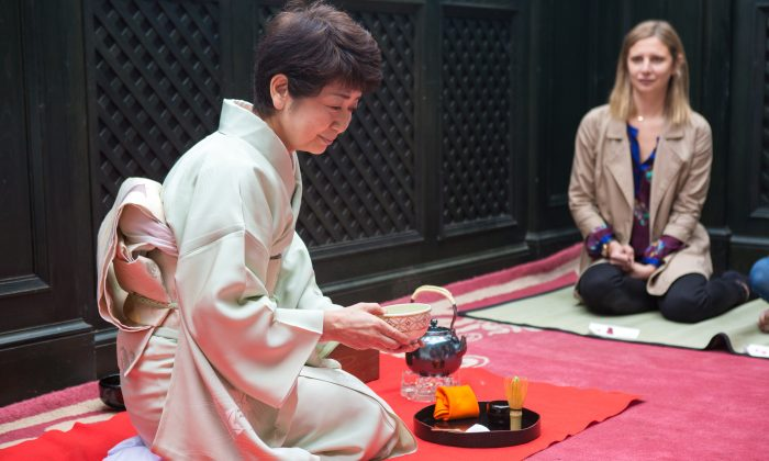 Miyako Watanabe performs a traditional tea ceremony at the Gramercy Park Hotel on the Terrace Garden in Manhattan on June 4, 2015. The tradition has been in her family since 1717.  (Benjamin Chasteen/Epoch Times)