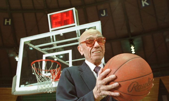 The late Danny Biasone, in the March 8, 1992 photo, was an innovator of the current 24-second shot clock. He met with other National Basketball Association owners met in Syracuse in 1954 and tested the 24-second clock at a basketball game in a local school. (AP Photo/Michael Okoniewski)