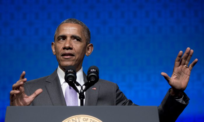 President Barack Obama gestures as he speaks to the Catholic Hospital Association Conference at the Washington Marriott Wardman Park in Washington, Tuesday, June 9, 2015. (AP Photo/Carolyn Kaster)