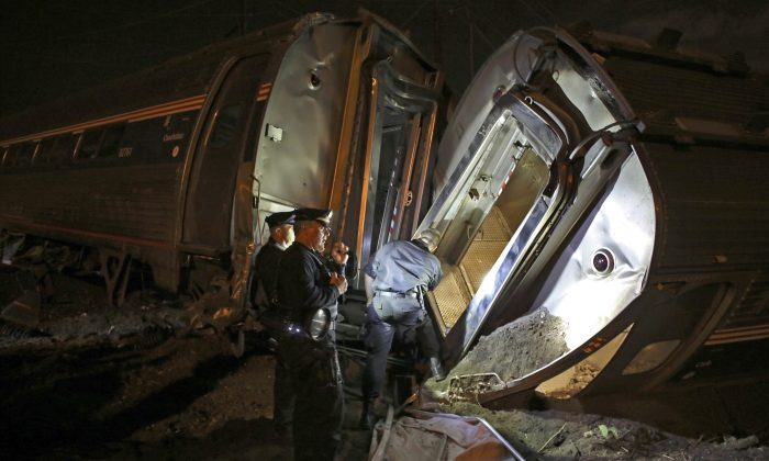 Emergency personnel work the scene of a train wreck in Philadelphia. (AP Photo/Joseph Kaczmarek)