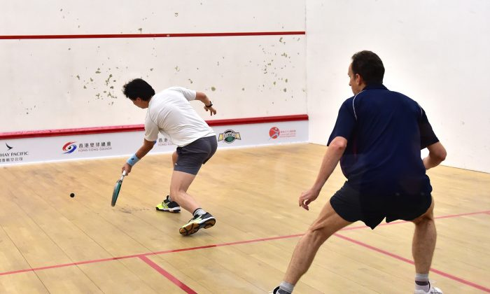 Peter Hill playing Hugh Dyus in the Final of the Mater's D Championship Final on Saturday June 6, 2015. Hill a master of ball placement and deception won the match 11-3, 11-5, 12-10 to take the title. Hill a past World Masters winner moves on to compete in the 2015 Hong Kong National Championship this week. (Bill Cox/Epoch Times)