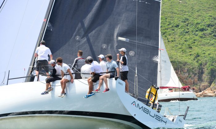 'Ambush' heading for the finish off Little Palm Beach, to beat Line Honours winner 'Zannekin' on corrected time to take IRC Division-A win in Race-1 of the Hebe Haven Quest Yachting Typhoon Series 2015 on June 7, 2015. (Bill Cox/Epoch Times)