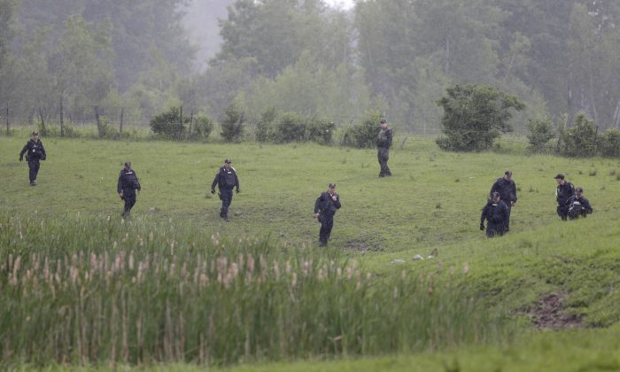 Law enforcement officers search for escaped prisoners near Essex, N.Y., Tuesday, June 9, 2015. State and federal law officers searching for two killers who used power tools to break out of a maximum-security prison poured into a small town 30 miles away Tuesday after getting a report of a possible sighting. (AP/Seth Wenig)