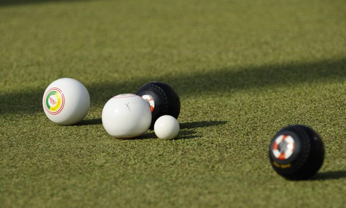 File photo: Lawn Bowls at its best: the cross on the white bowl indicates that it has touched the Jack (the small white ball). 'Touchers' still count if they are closest to the Jack if they are subsequently forced into the ditch surrounding the green, whereas 'non-touchers' don't. (Stephanie Worth)