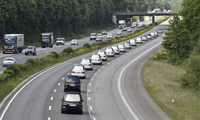 A convoy of hearses drives on the highway in Duisburg, Germany, Wednesday, June 10, 2015, taking home 16 school children who died in the Germanwings plane crash in March. The coffins, that arrived at the airport in Duesseldorf Tuesday evening, are brought to their families in the city of Haltern. (AP/Martin Meissner)